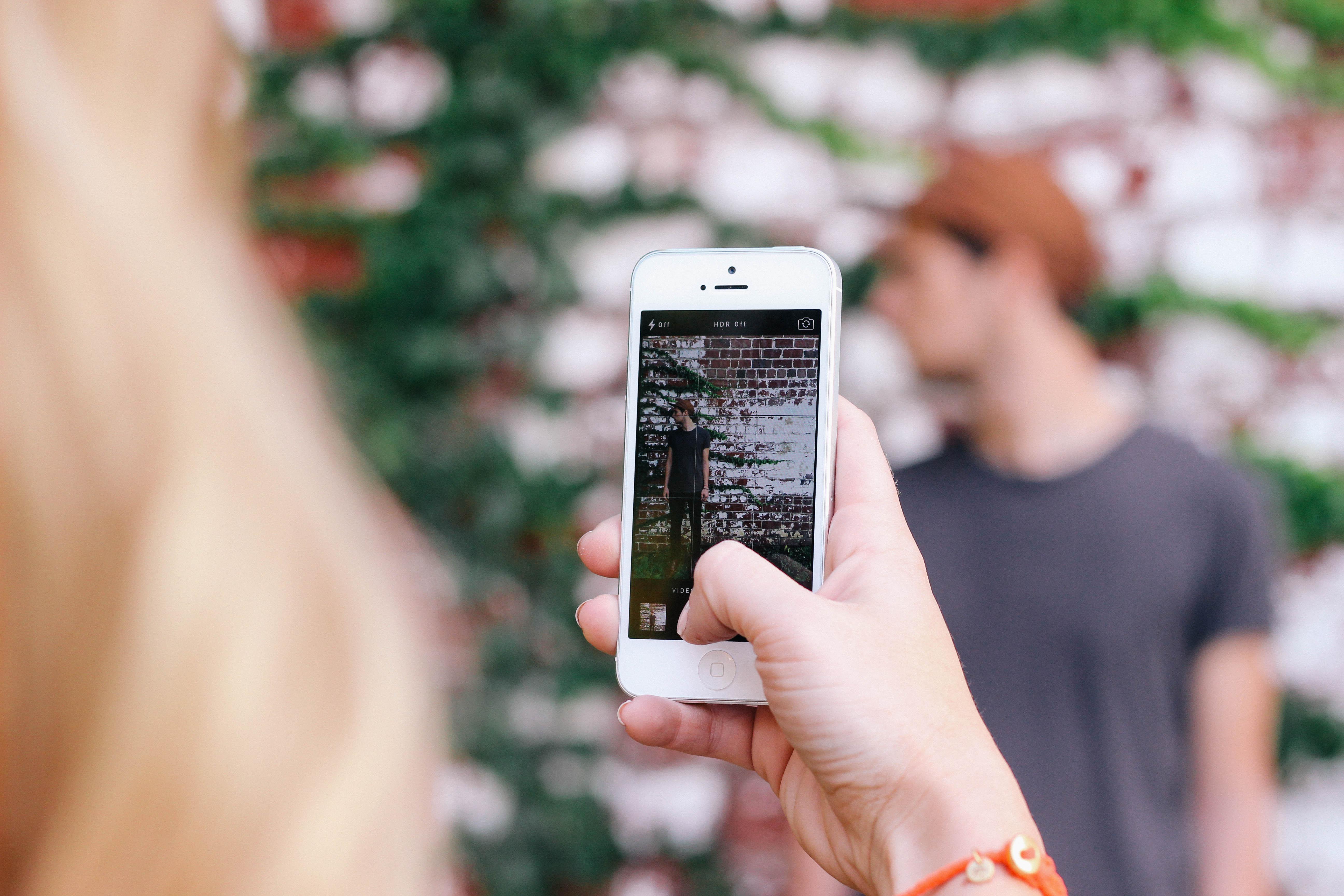 marketing to millennials, marketing gardening, millenial marketing guide, garden media group, taking a picture with phone, digital marketing