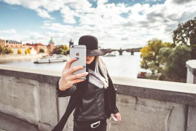 young-woman-taking-a-selfie-with-her-iphone-picjumbo-com-1.jpg